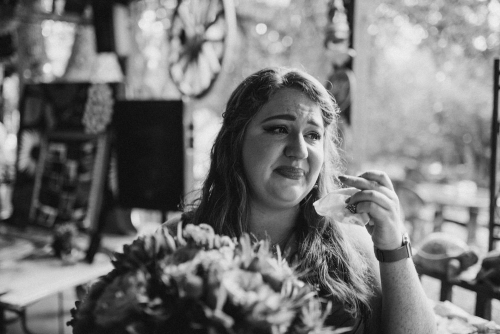 intimate, eclectic austin wedding jennifer getting emotional reading vows