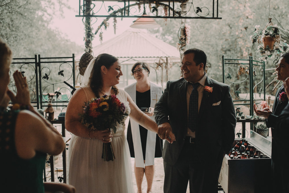 intimate, eclectic austin wedding couple holding hands at altar