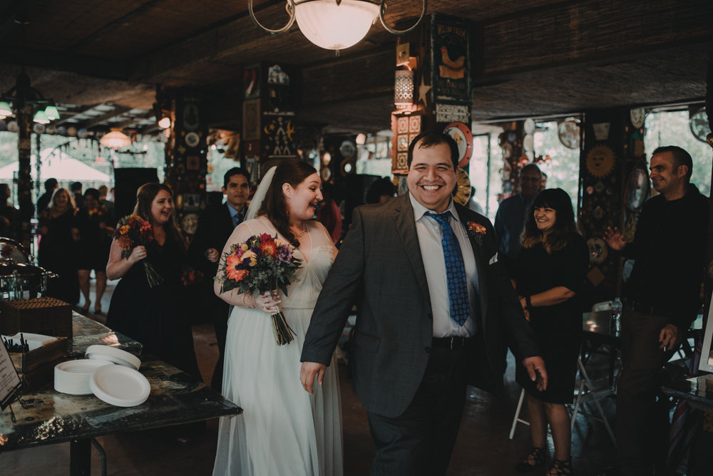 intimate, eclectic austin wedding couple entering reception