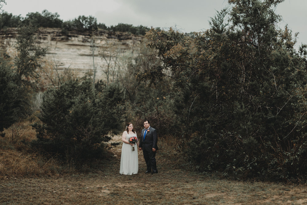 intimate, eclectic austin wedding couple in front of trees