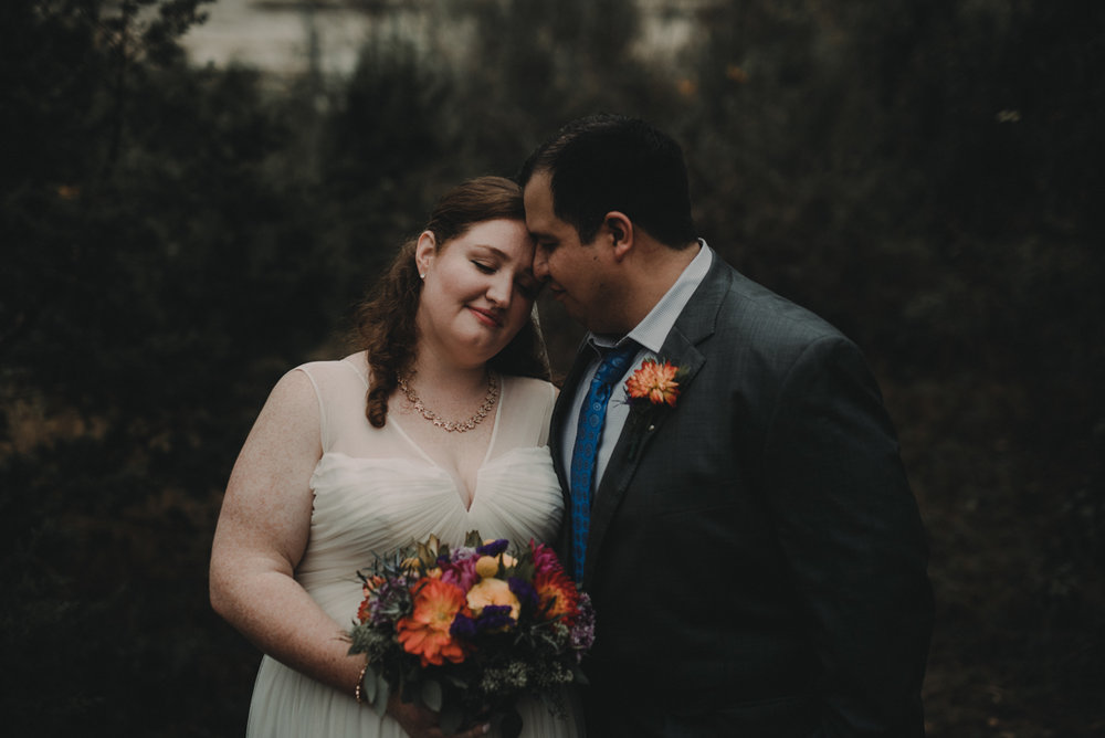 intimate, eclectic austin wedding couple embracing