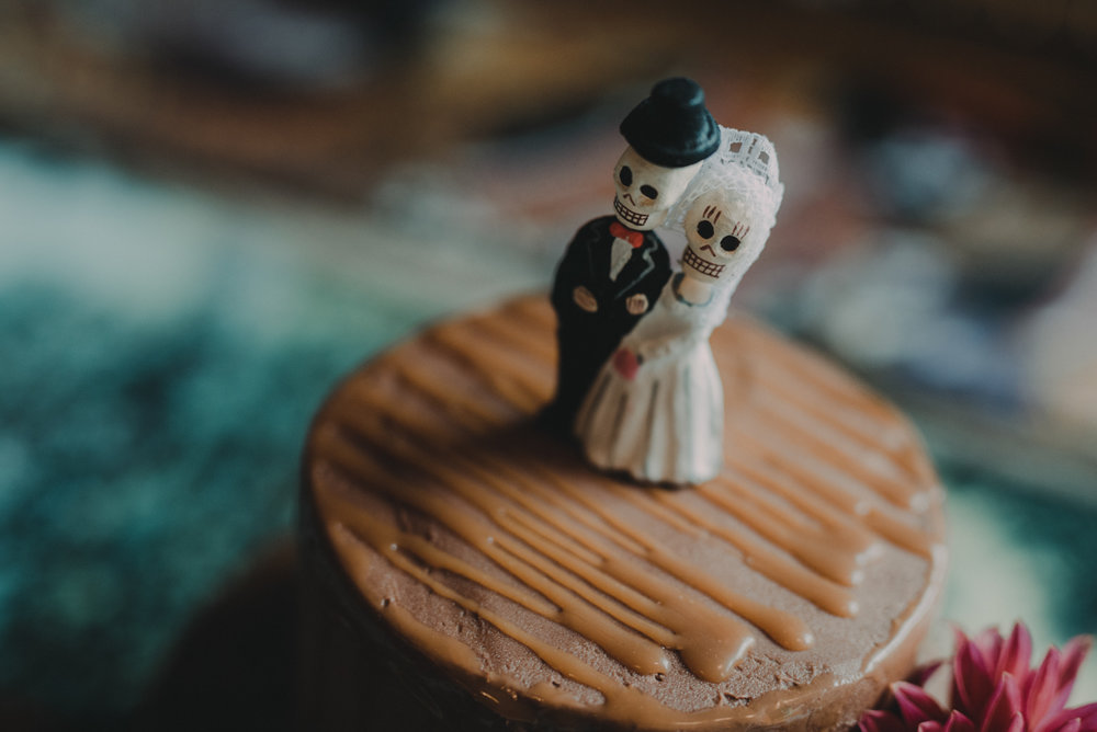 intimate, eclectic austin wedding cake topper on cake