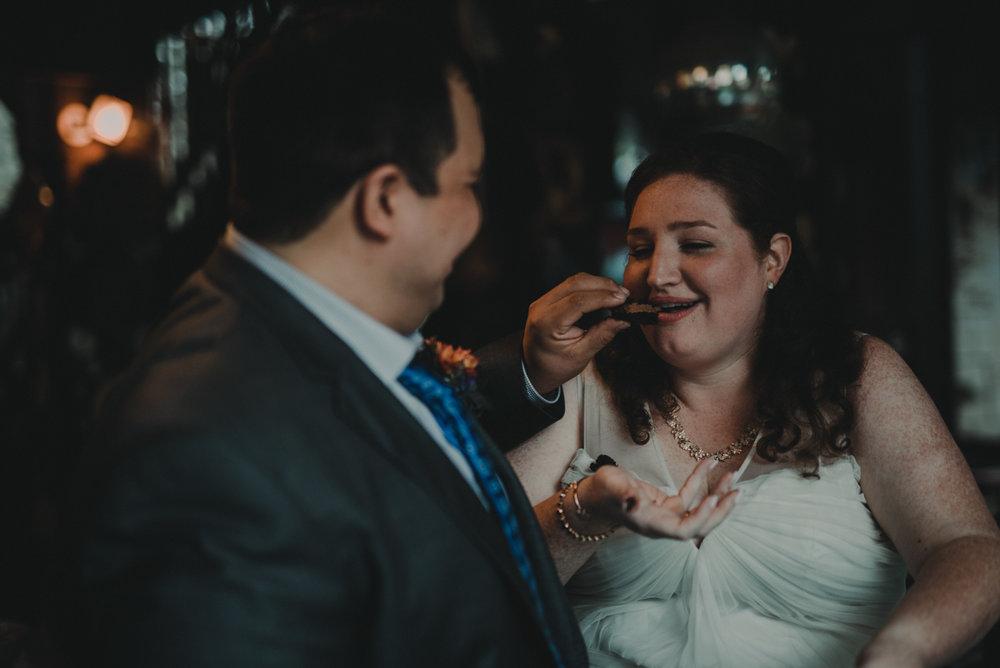 intimate, eclectic austin wedding juan giving jennifer cake