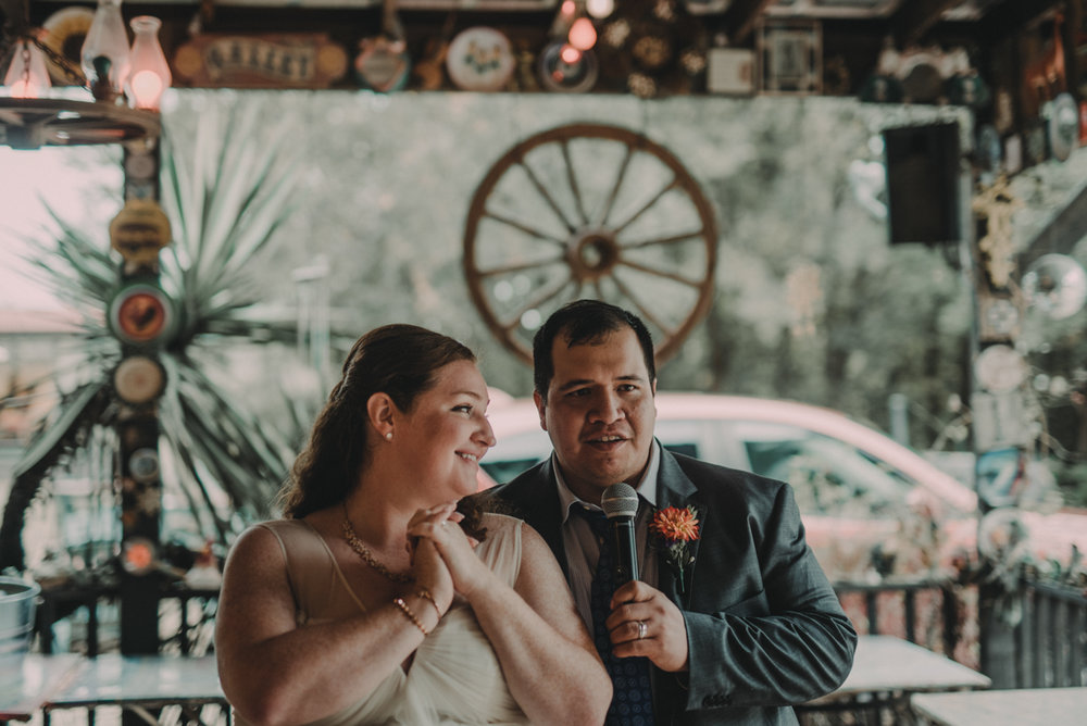 intimate, eclectic austin wedding juan and jennifer making announcement