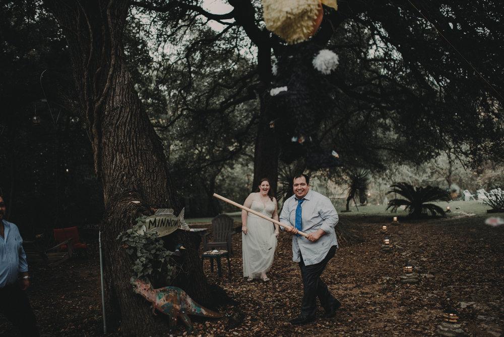 intimate, eclectic austin wedding juan hitting pinata