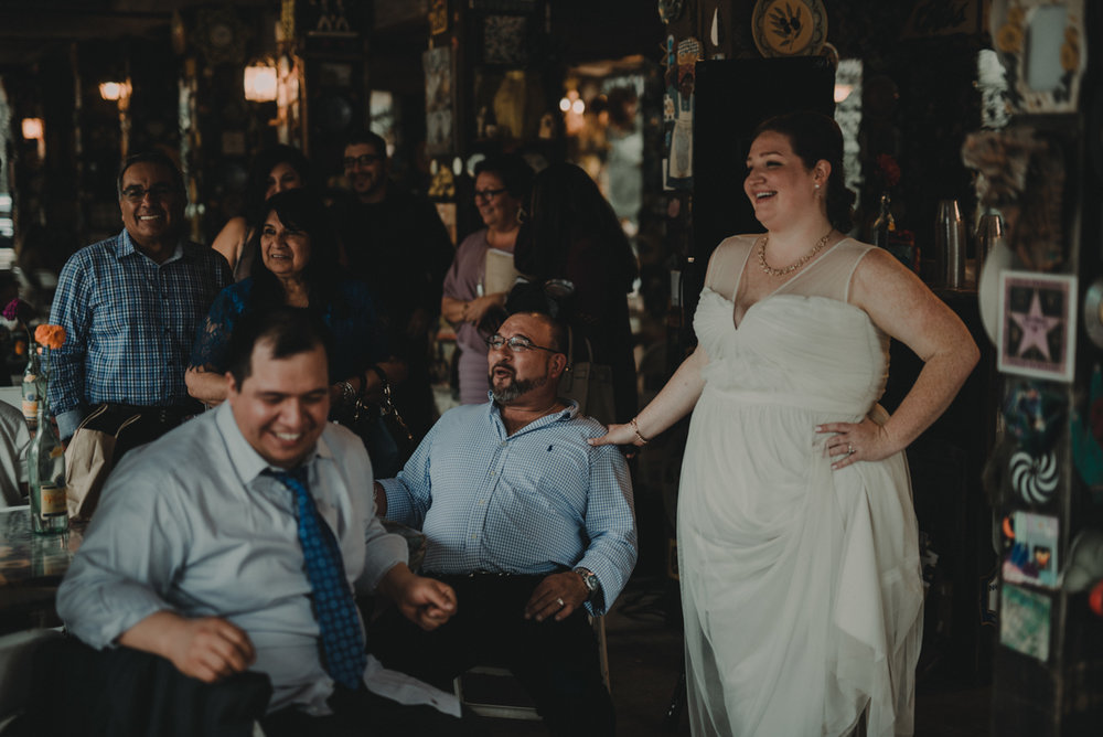 intimate, eclectic austin wedding couple with guests
