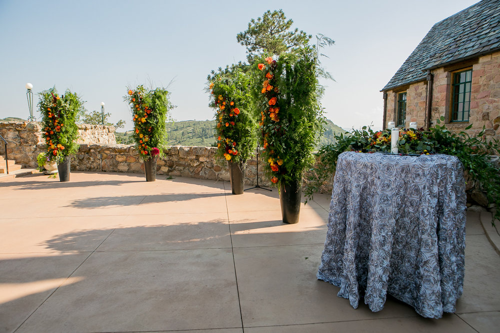 colorado castle wedding table with candles and potted trees outside