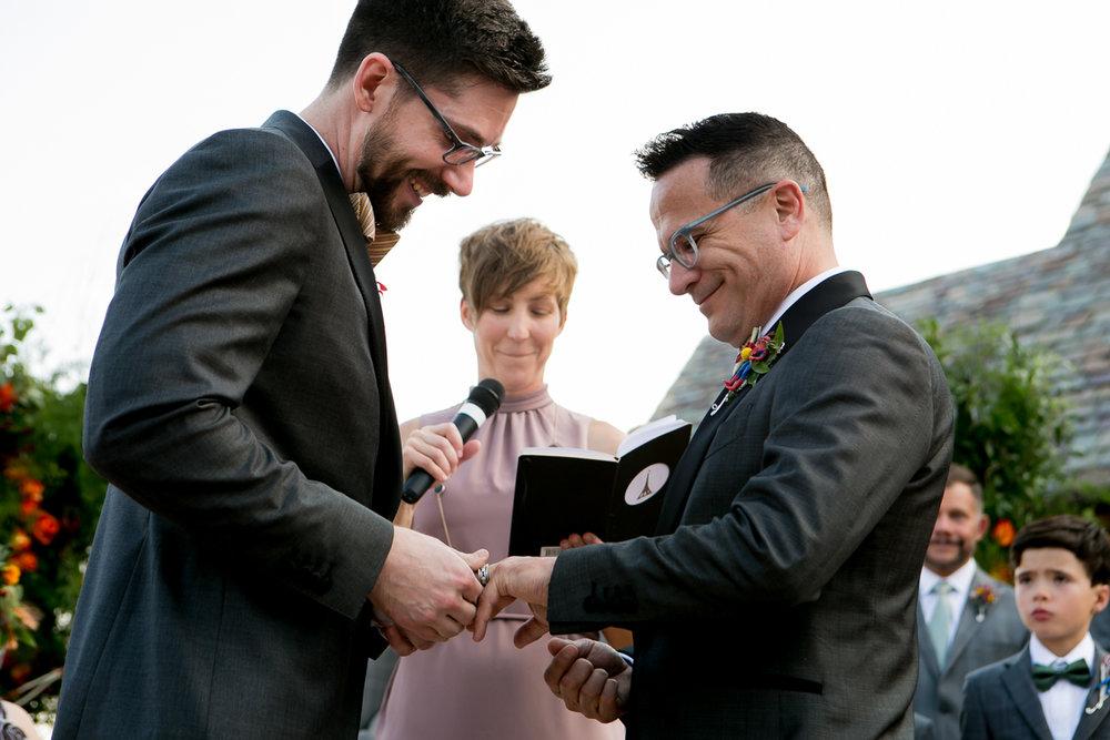 colorado castle wedding exchanging rings