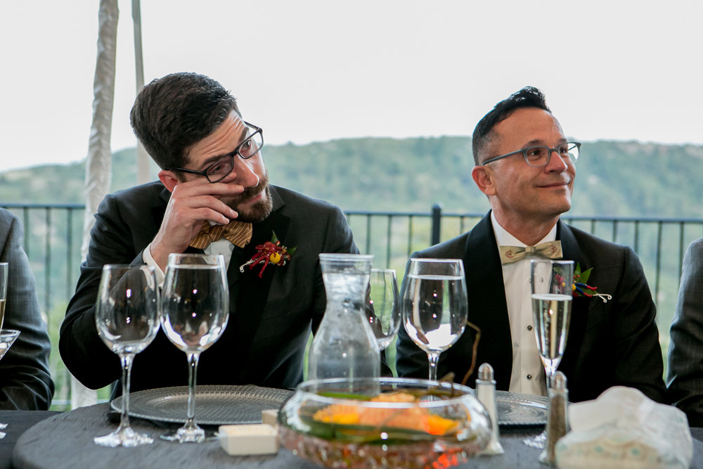 colorado castle wedding grooms at head table listening to speeches