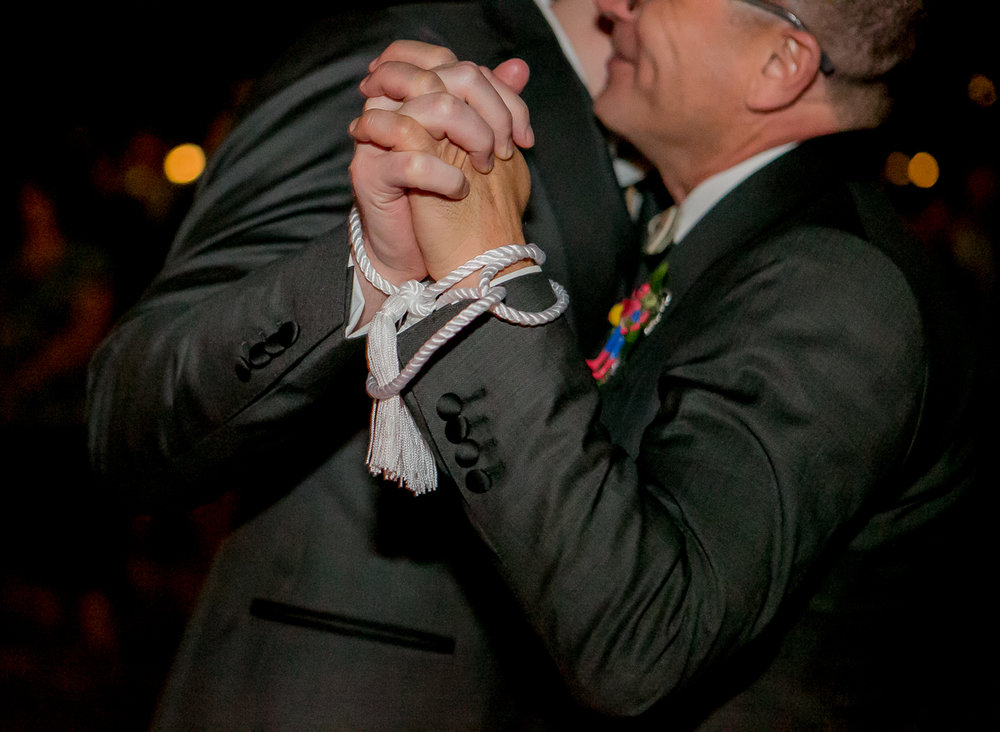 colorado castle wedding couple's wrists tied with cord