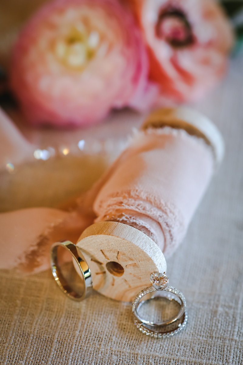 Dreamy pastels dallas texas rings leaning against ribbon spool