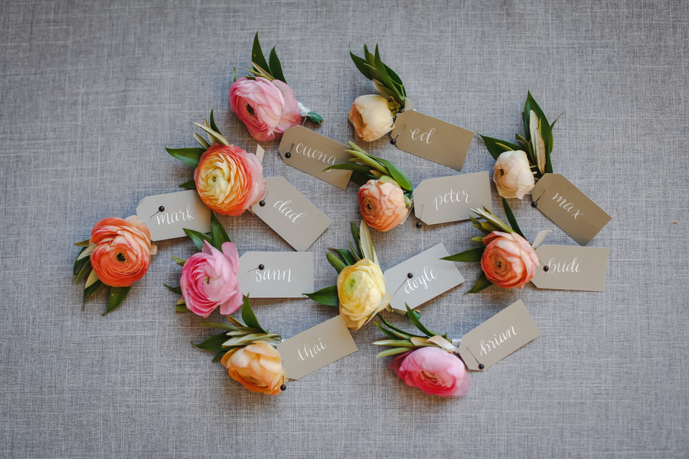 Dreamy pastels dallas texas guests' name tags pinned to flowers