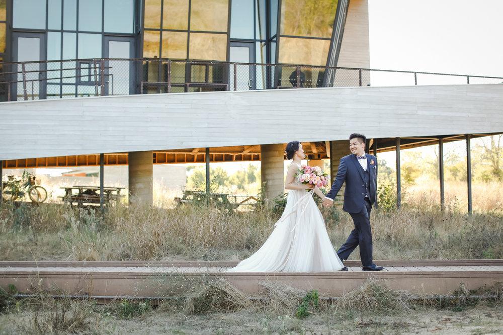 Dreamy pastels dallas texas couple walking outside venue