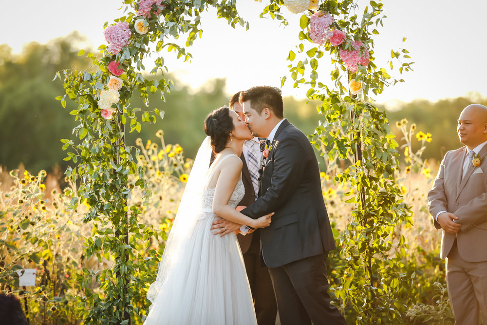 Dreamy pastels dallas texas kiss at ceremony