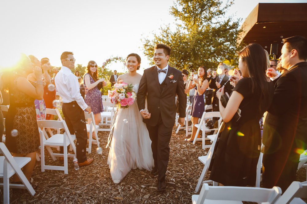 Dreamy pastels dallas texas couple leaving ceremony