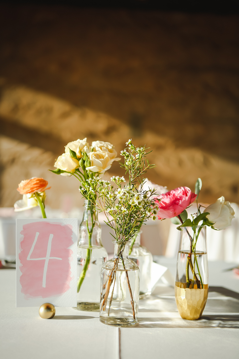 Dreamy pastels dallas texas table with flowers in bottles