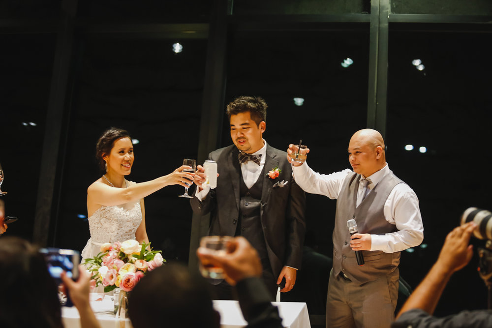 Dreamy pastels dallas texas couple and groomsman leading toast