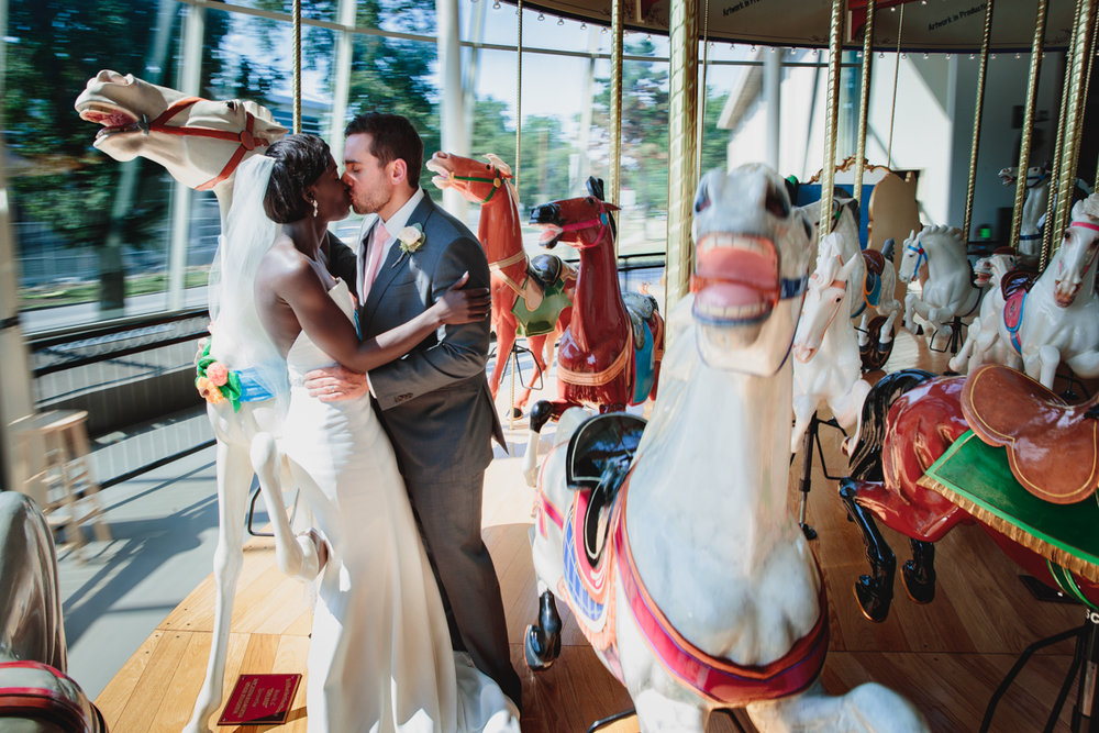 Glam cleveland museum wedding kiss on carousel