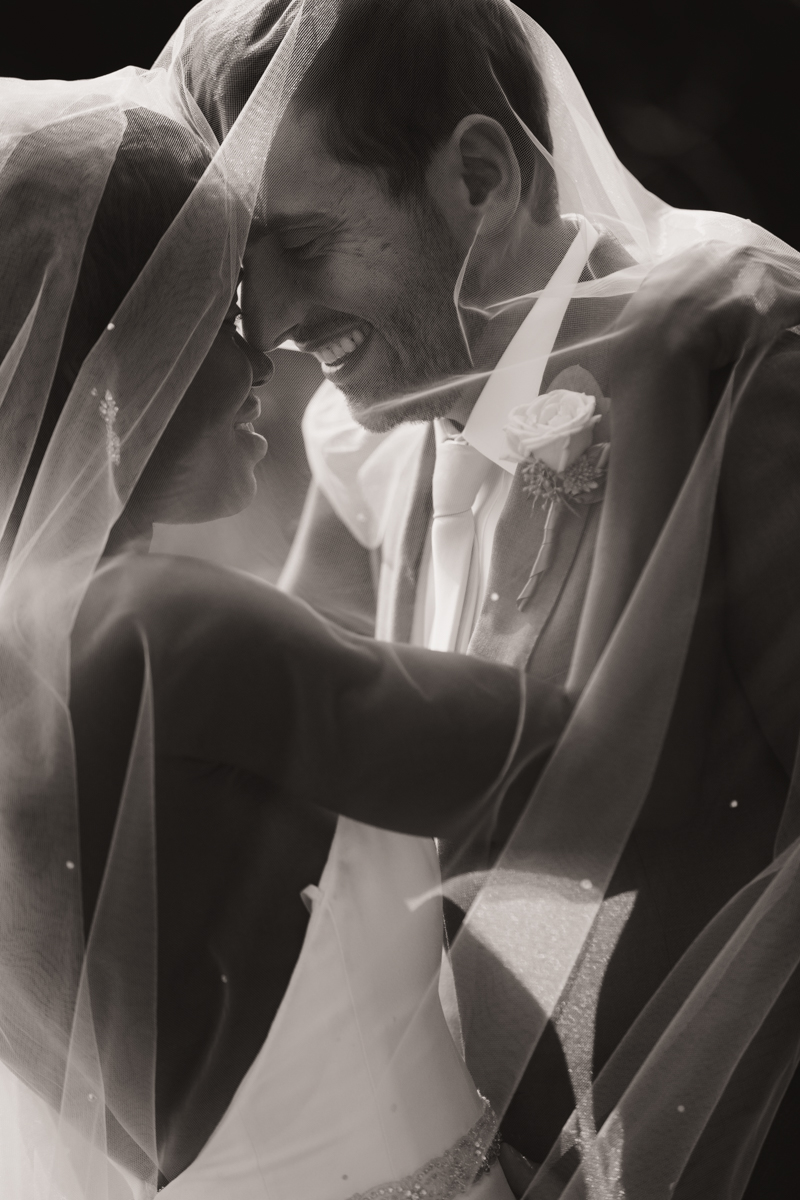 Glam cleveland museum wedding embrace under wedding veil