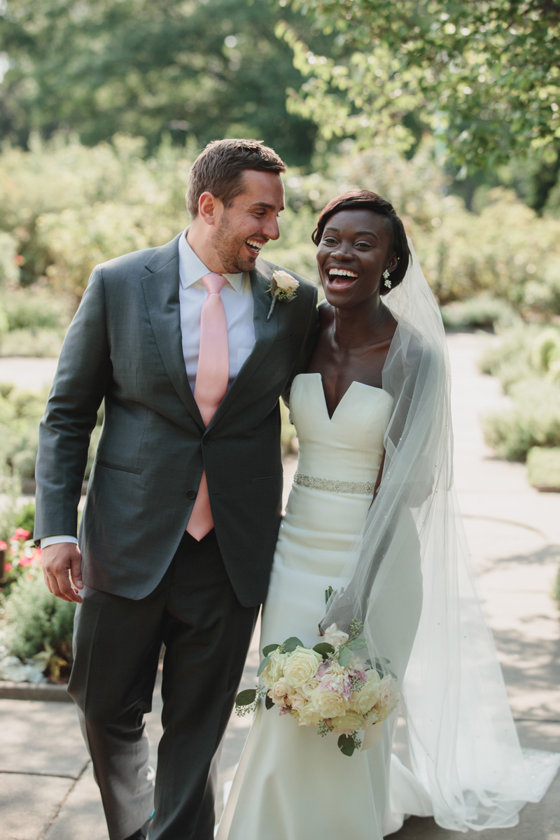 Glam cleveland museum wedding couple laughing in garden