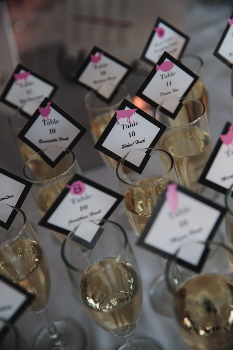 Glam cleveland museum wedding guests' name cards on champagne glasses