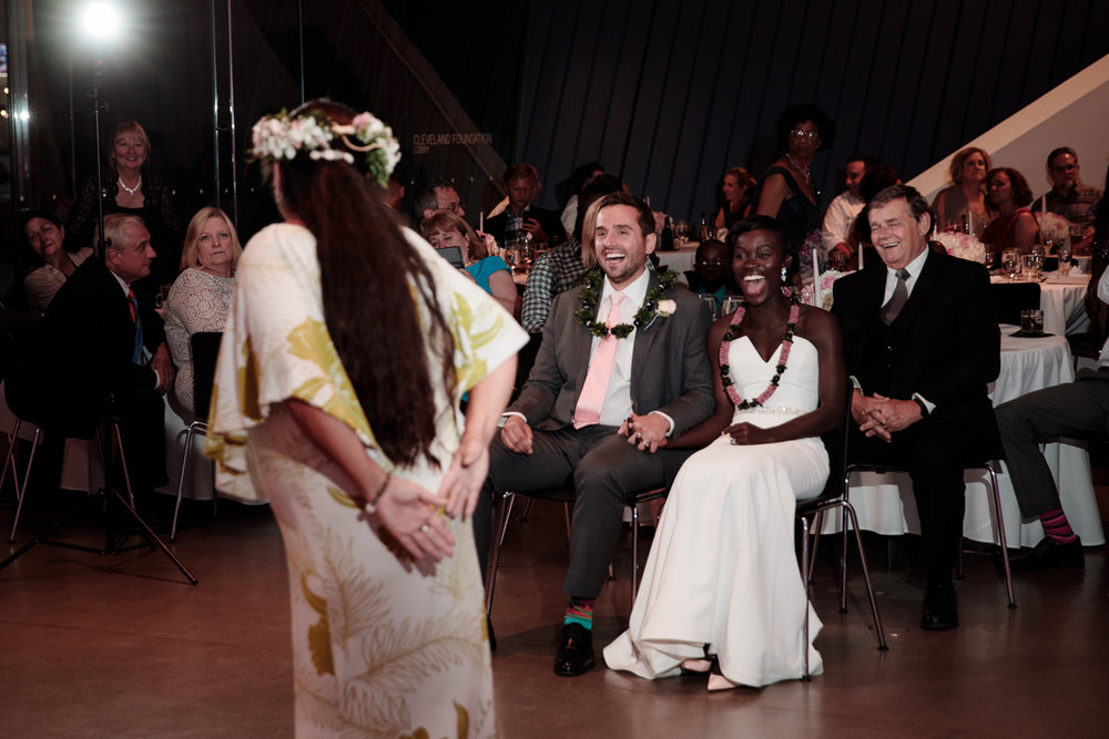 Glam cleveland museum wedding couple and guests watching tahitian dance ceremony