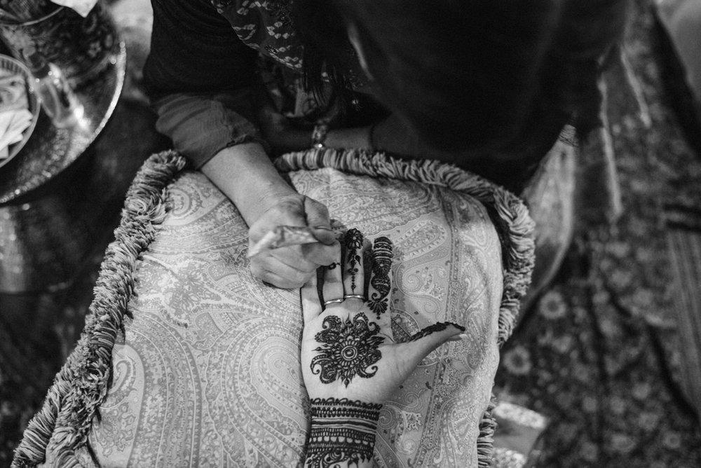 DENVER SAME-SEX INDIAN WEDDING HENNA BEING APPLIED TO BRIDE'S PALM