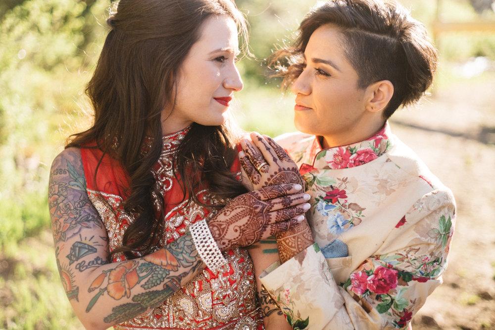 DENVER SAME-SEX INDIAN WEDDING BRIDES HOLDING HANDS