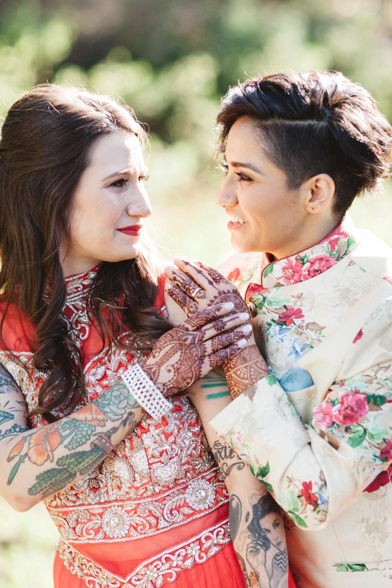 DENVER SAME-SEX INDIAN WEDDING DENVER SAME-SEX INDIAN WEDDING BRIDES SMILING AND HOLDING HANDS