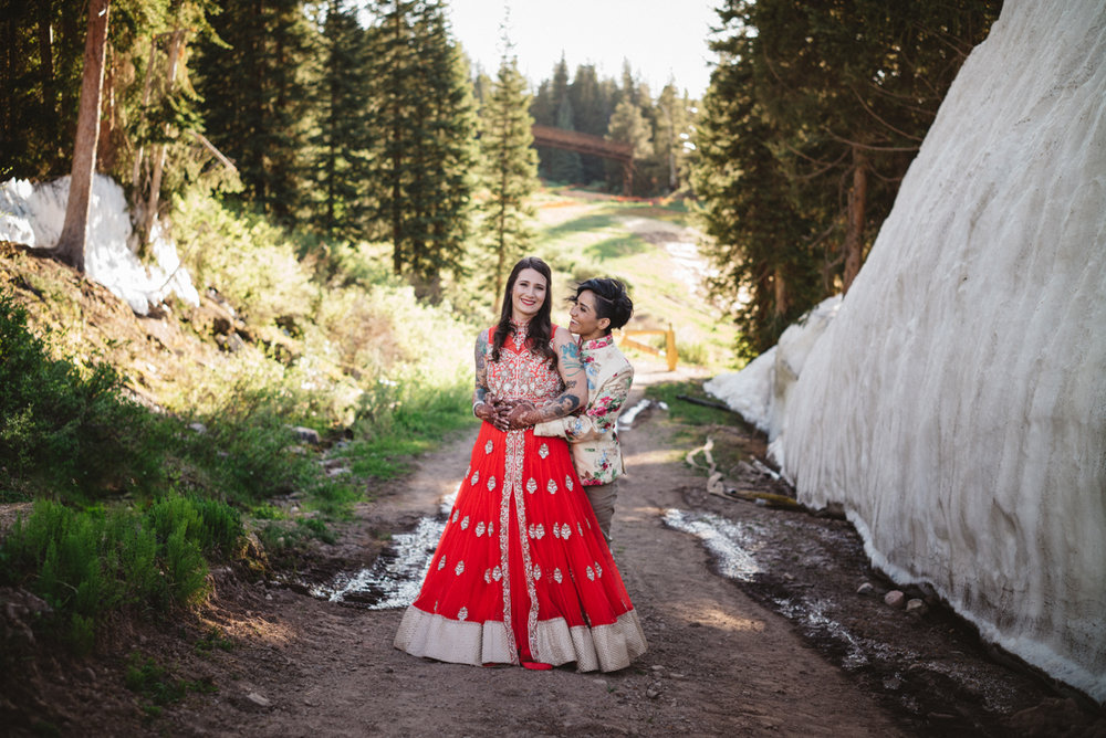 DENVER SAME-SEX INDIAN WEDDING EMBRACE ON MOUNTAIN PATH