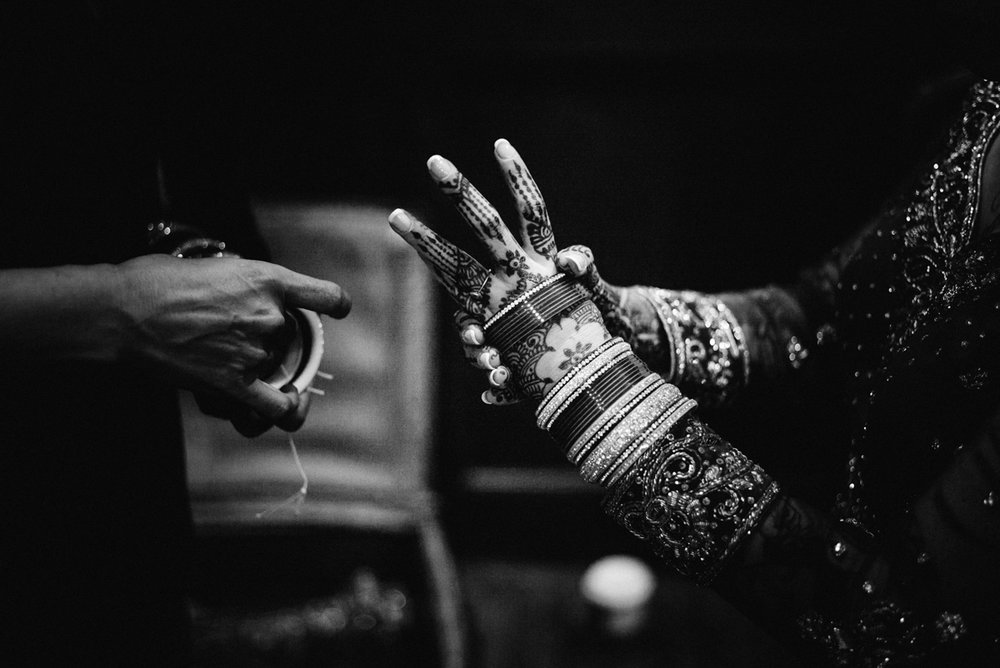 Denver Same-Sex Indian Wedding albertine putting on bangles
