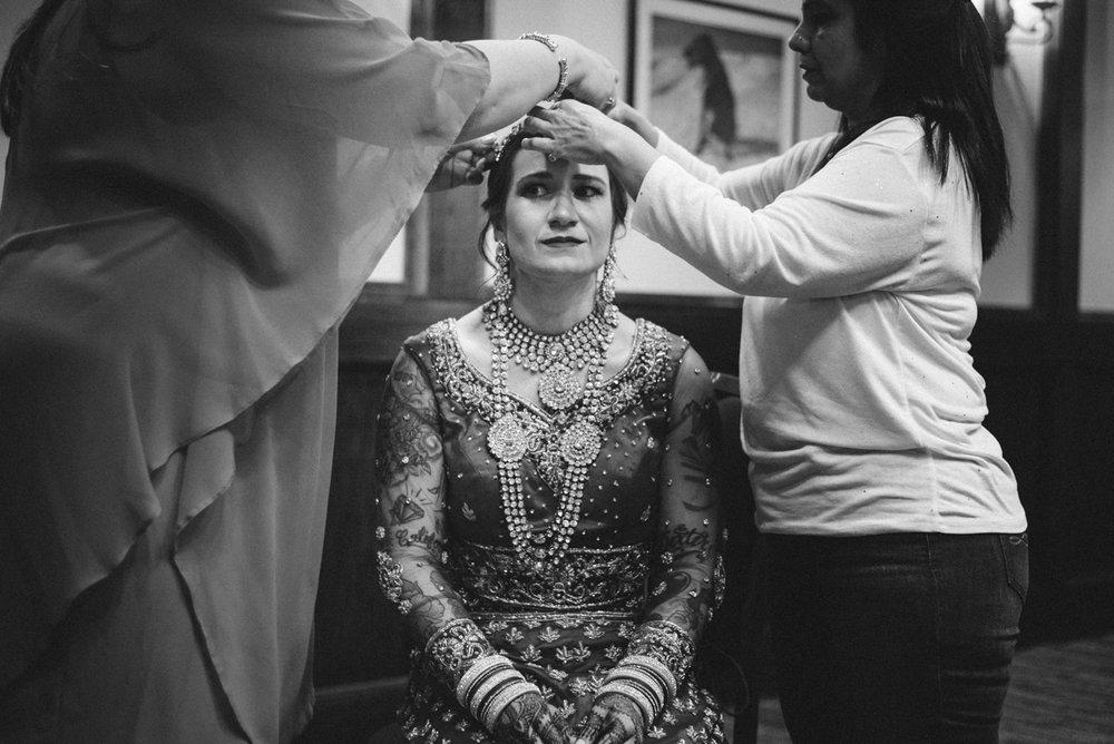 Denver Same-Sex Indian Wedding albertine having maang tikka put on