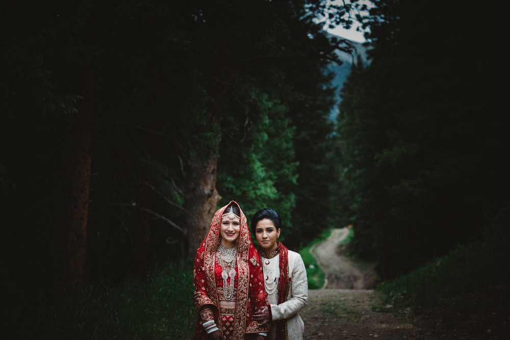 Denver Same-Sex Indian Wedding couple on woods path