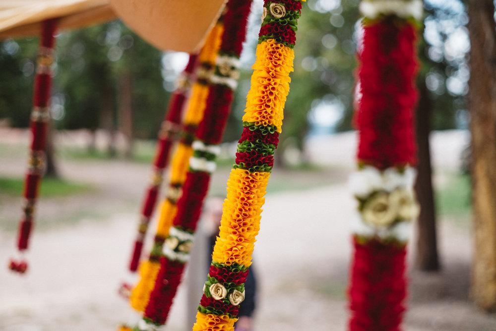 Denver Same-Sex Indian Wedding garlands on mandap