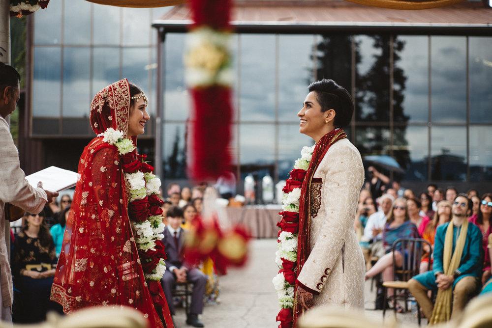 Denver Same-Sex Indian Wedding couple at altar/mandap
