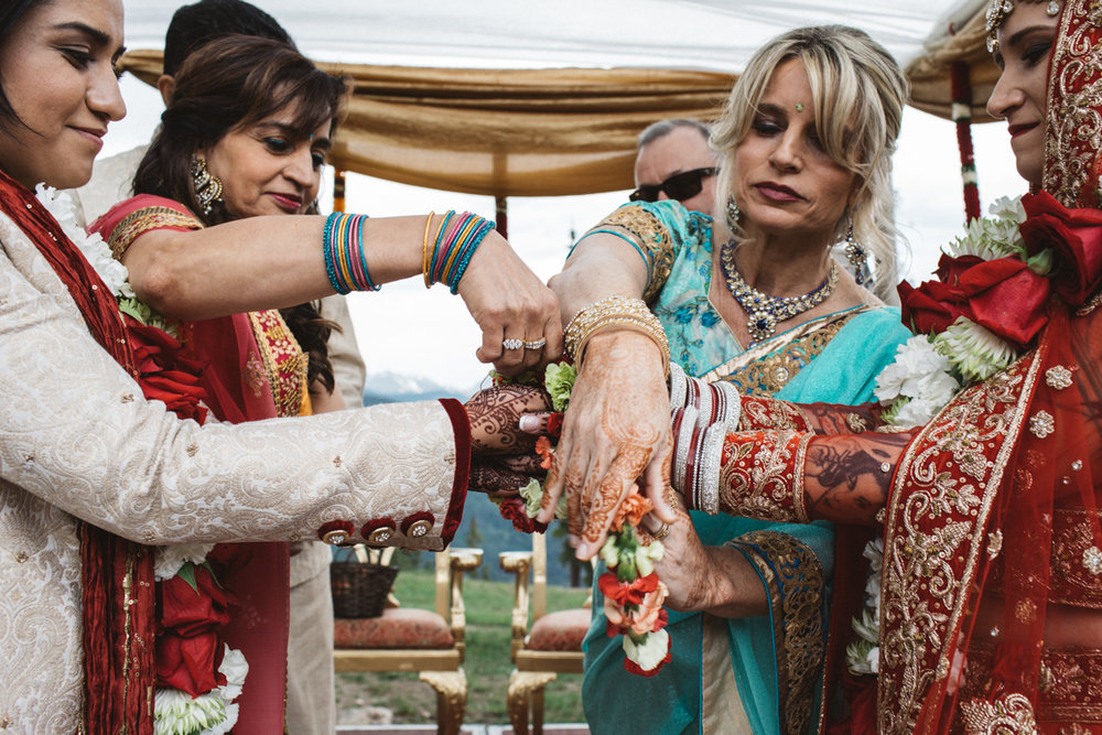 Denver Same-Sex Indian Wedding parents tying hands (kanyaadaan)
