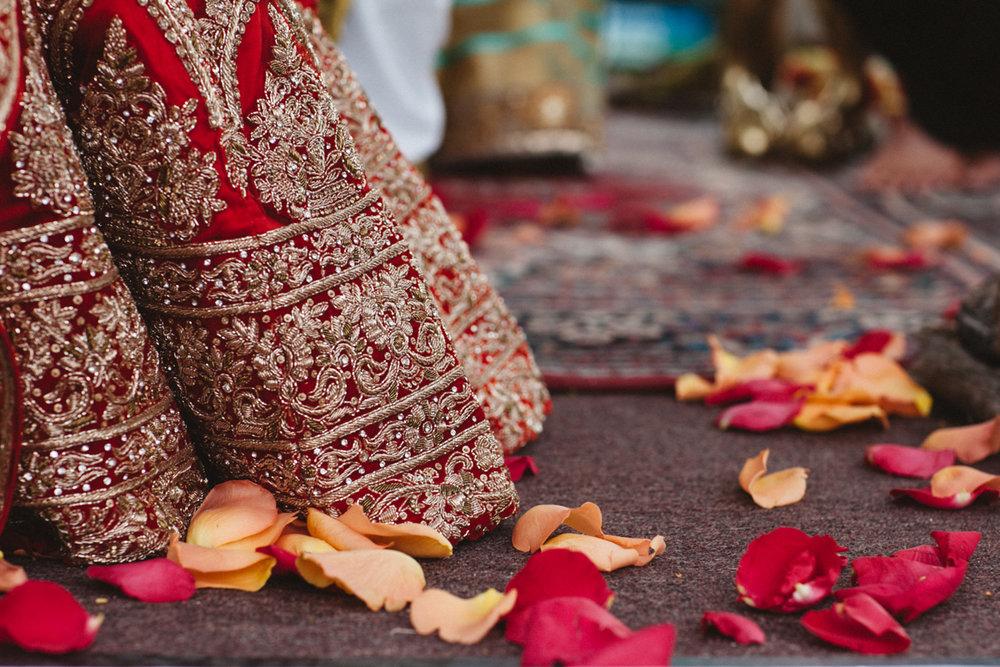 Denver Same-Sex Indian Wedding flower petals on ground with hem of albertine's dress