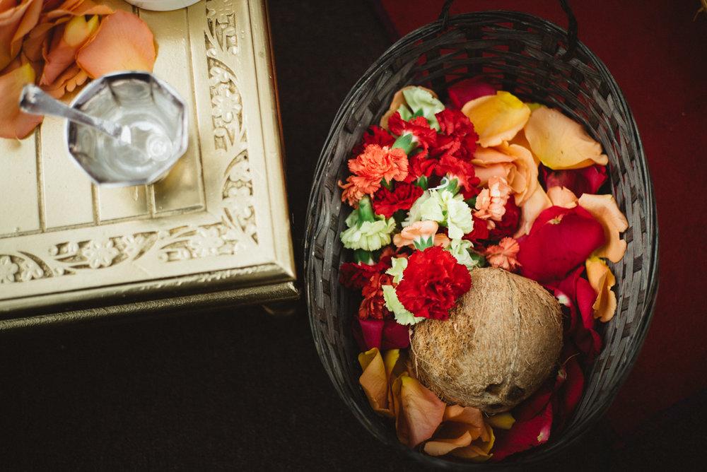 Denver Same-Sex Indian Wedding basket with coconut and flowers inside