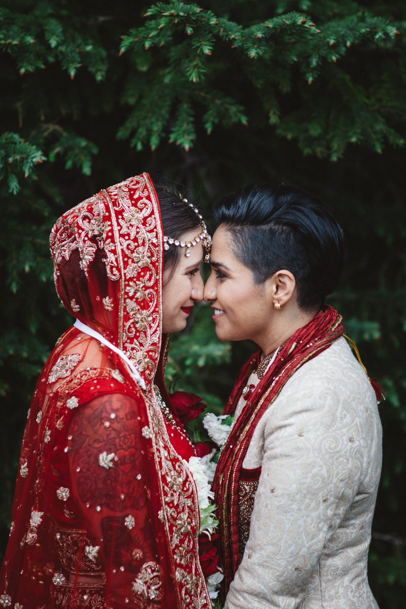denver same-sex indian wedding foreheads touching