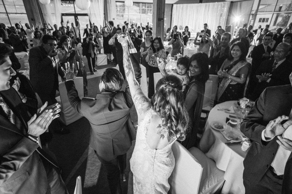 denver same-sex indian wedding newlyweds entering reception
