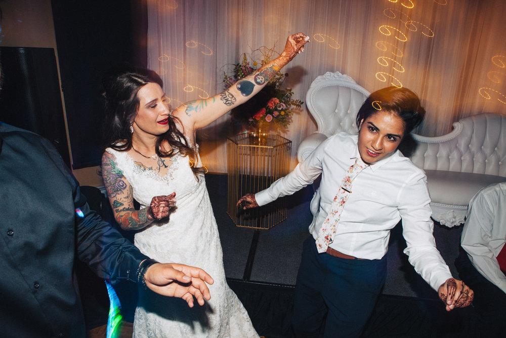 denver same-sex indian wedding couple on dance floor