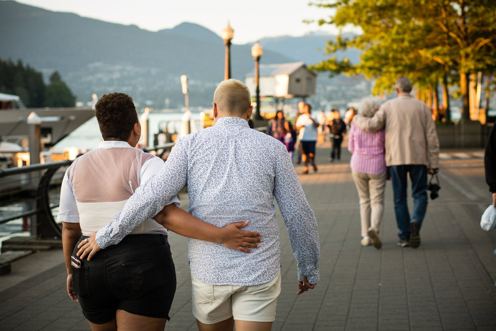"""vancouver """"just because"""" photo shoot walking down boardwalk with arms around each other"""