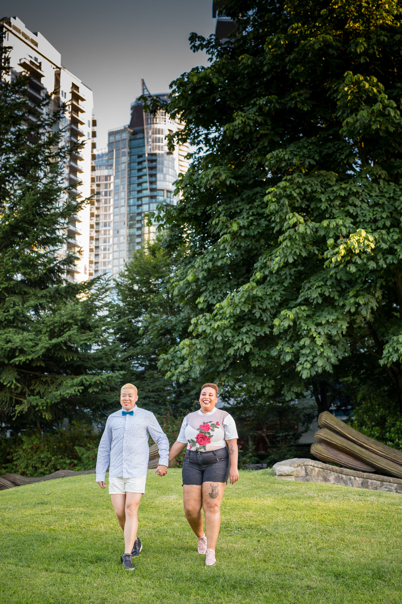 """vancouver """"just because"""" photo shoot walking in park near sculpture"""