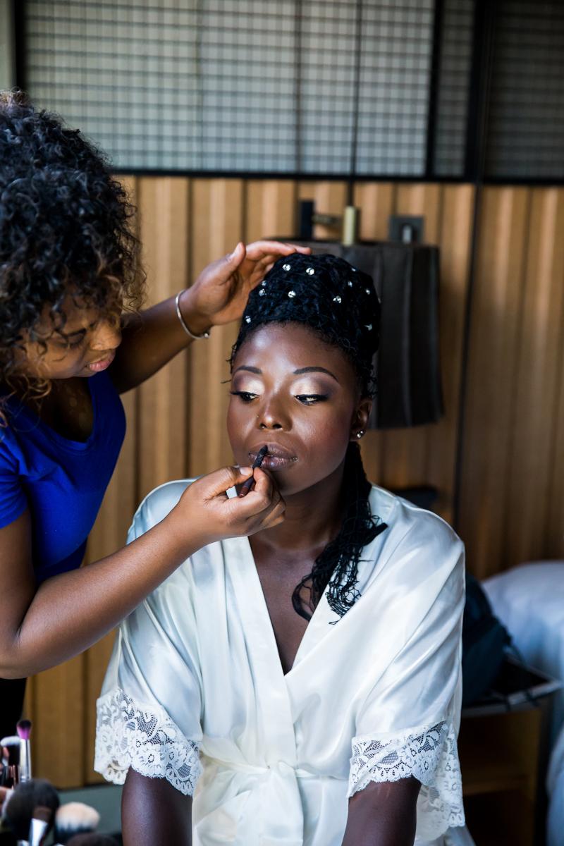 Caribbean NYC wedding sylvia having makeup done