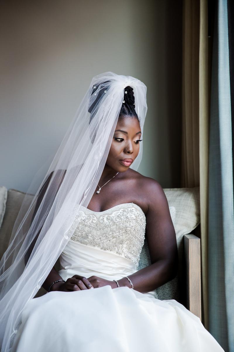 Caribbean NYC wedding sylvia in dress sitting by window