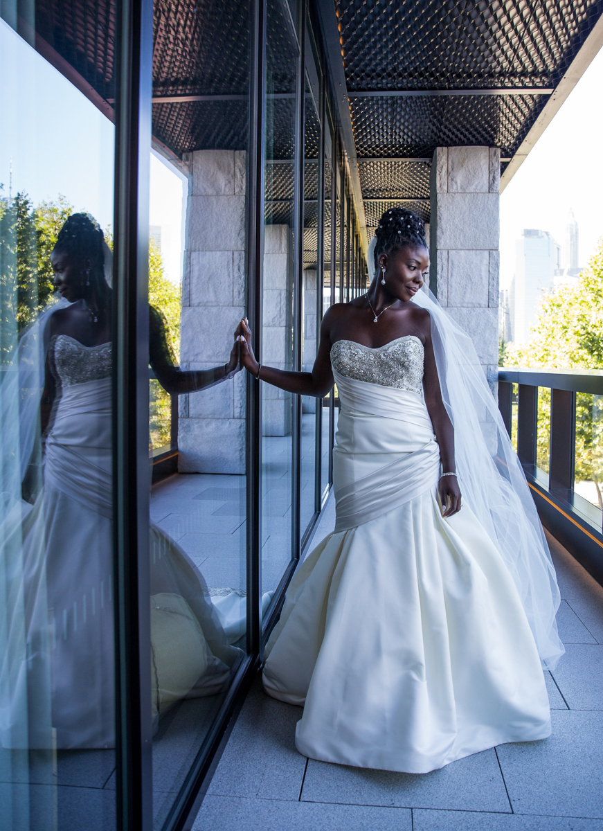 Caribbean NYC wedding sylvia posing in front of reflective window