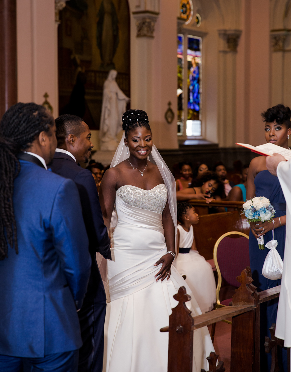 Caribbean NYC wedding couple at altar during ceremony