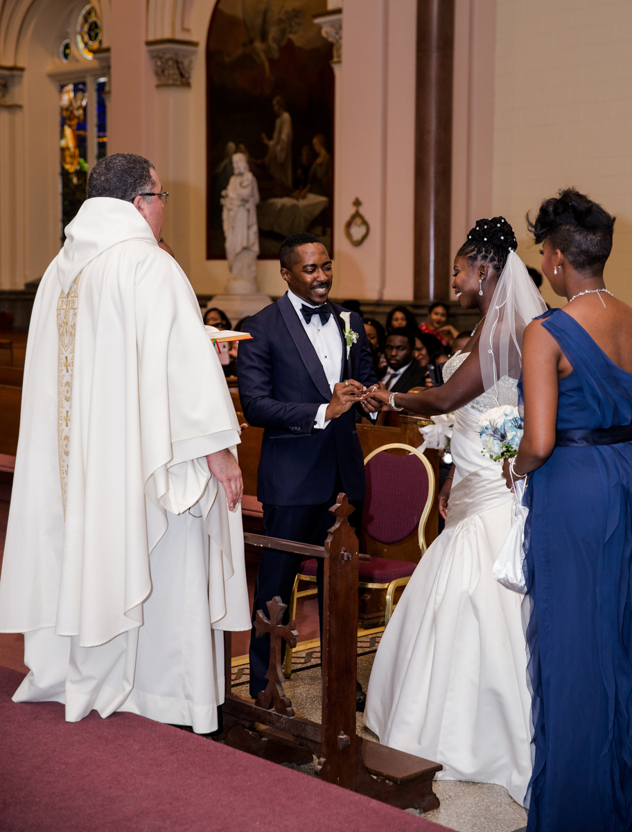Caribbean NYC wedding jason putting ring on sylvia