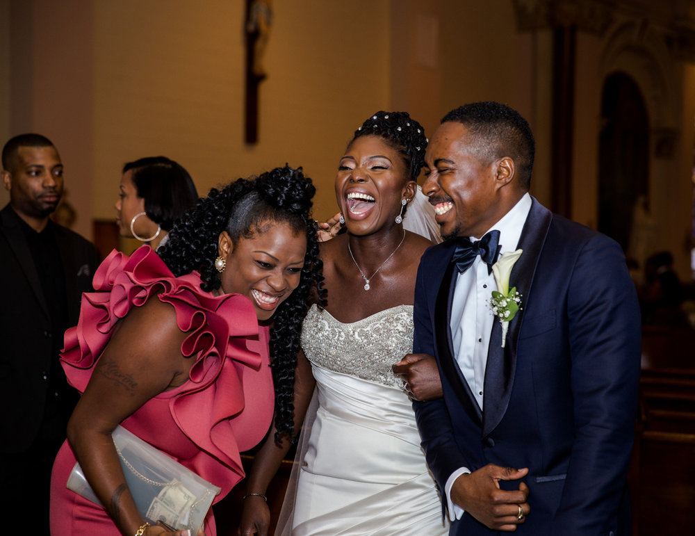 Caribbean NYC wedding couple laughing with guest after ceremony