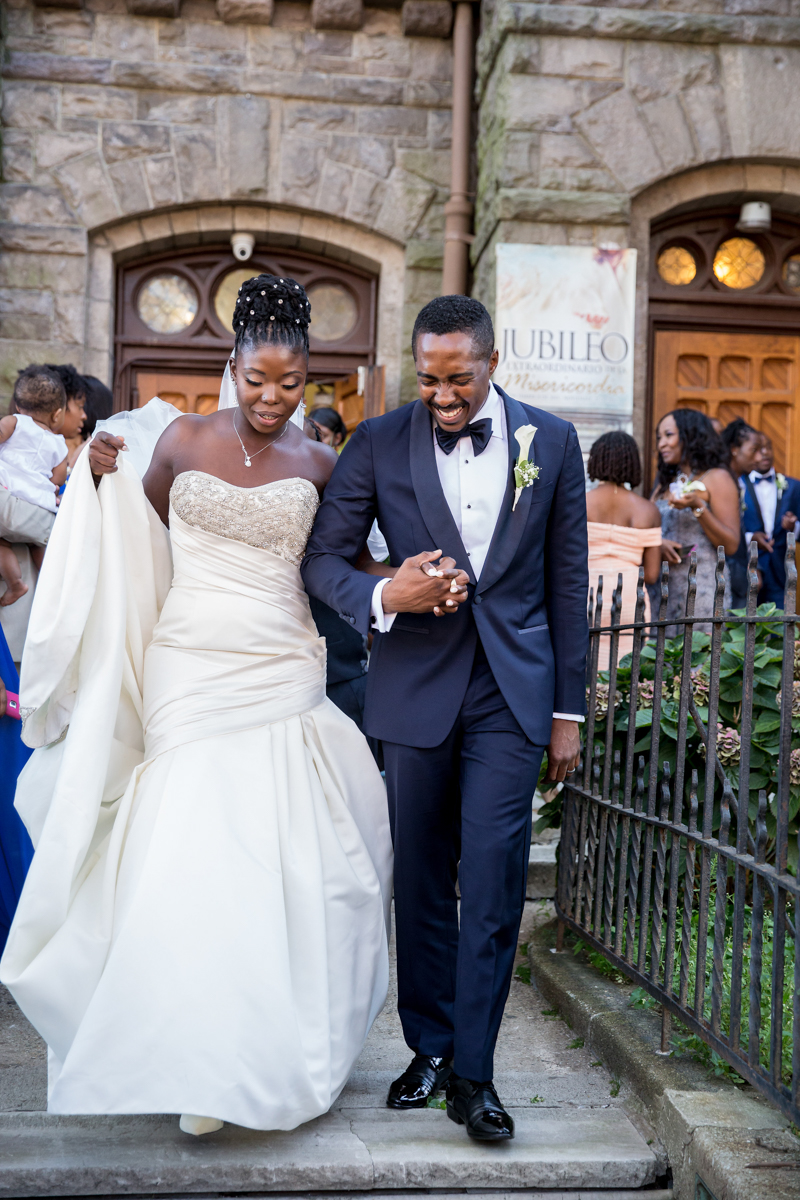 Caribbean NYC wedding couple leaving church holding hands